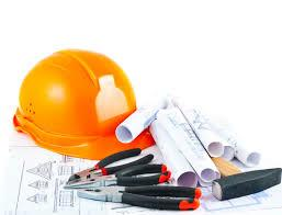 Image of orange hard hat and engineering plans