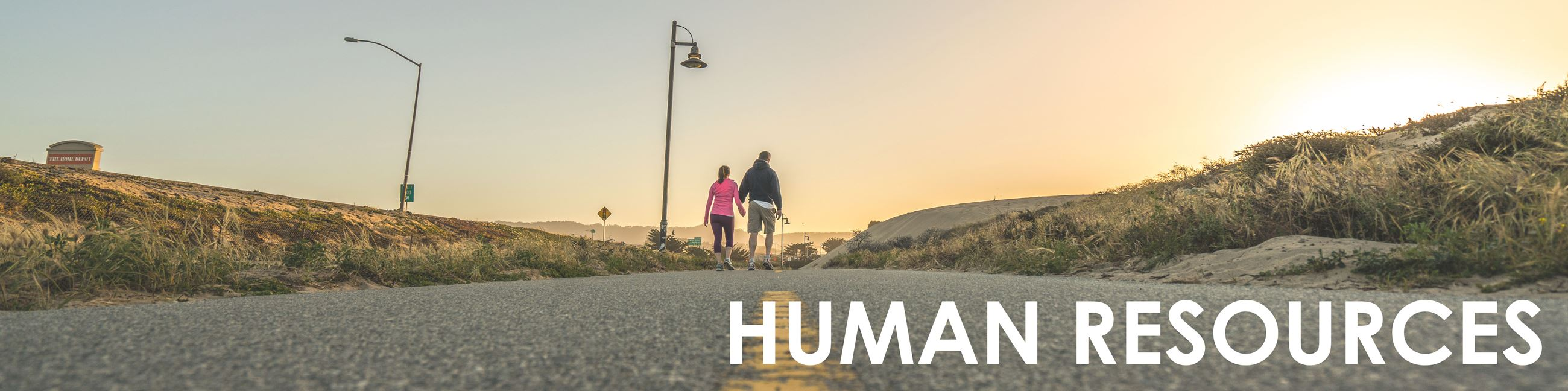 """Human Resources"" image of people walking on trail"