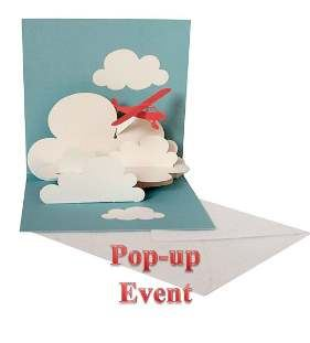 Pop up card with clouds and red airplane
