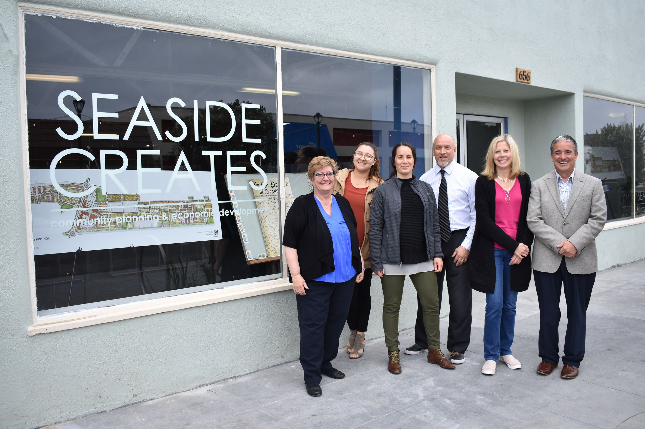 Seaside Creates staff members standing in front of Seaside Creates building